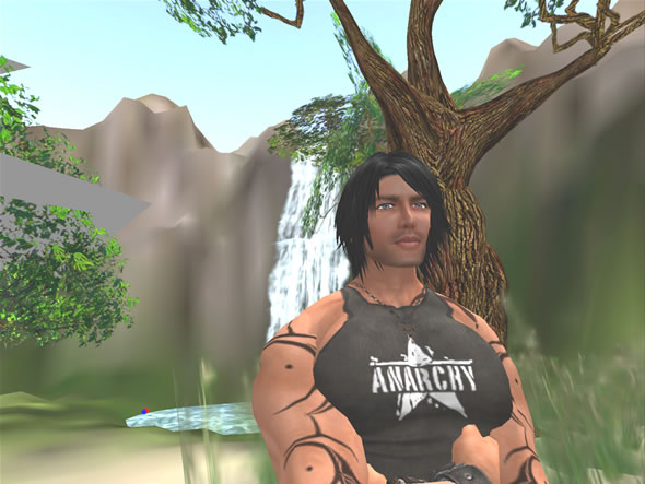 Sexy Beach owner, Gunter Vandyke, poses in front of an island waterfall.