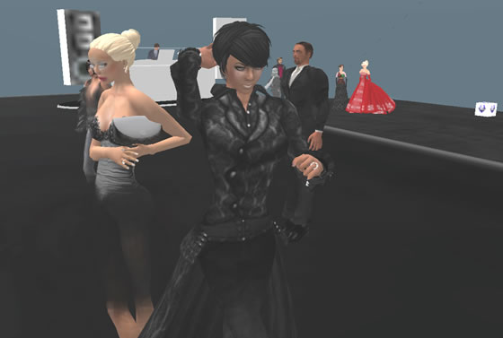 Rusch Raymaker turns heads in her sassy and sleek pant suit designed by Silent Sparrow.